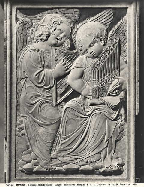 Agostini di Duccio ~ mid 15th century relief from Rimini Cathedral. One of the angels plays an organetto wtih two alternating bellows. - PInterest