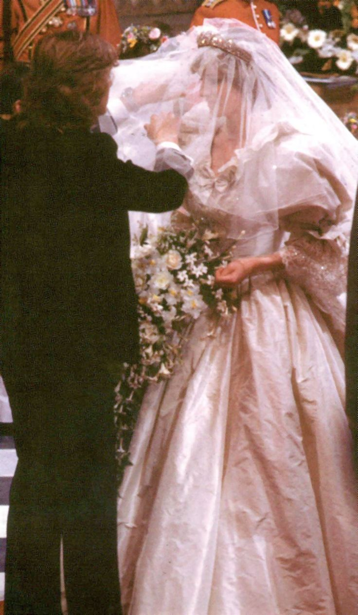 David Emanuel Puts The Finishing Touches Onto Lady Diana Before She Proceeds Down Aisle To Marry Price Charles
