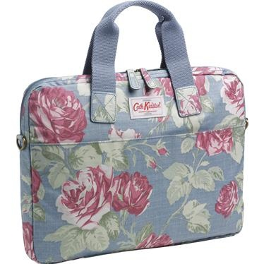 Our Antique Rose laptop case is a super stylish way to carry your computer. Made from our new, lightweight, matt coated oilcloth, it's easy to care for and has a memory foam inner layer to protect your laptop from knocks and scratches. The design also features lots of handy pockets for accessories and a removable shoulder strap, making it easy to carry.This laptop bag is designed to fit securely on top of our four-wheeled matching suitcase.