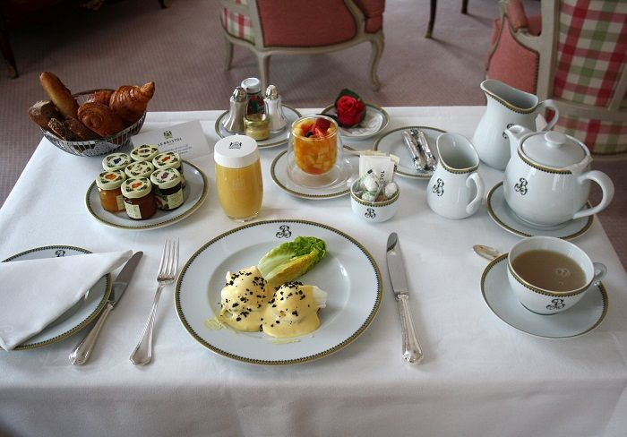Eggs Benedict with shaved black truffles and croissants for breakfast at Le Bristol Paris