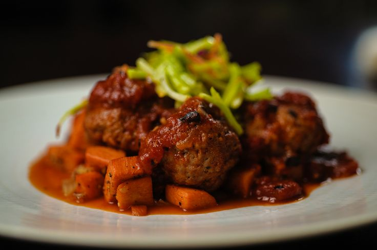 Pork Meatballs with Tomato & Fig Sauce over a Bed of Sauteed Sweet Potatoes