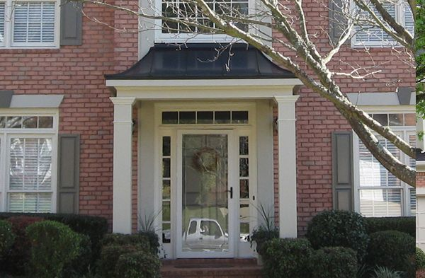A hip roof portico features downward sloping sides for House plans with portico