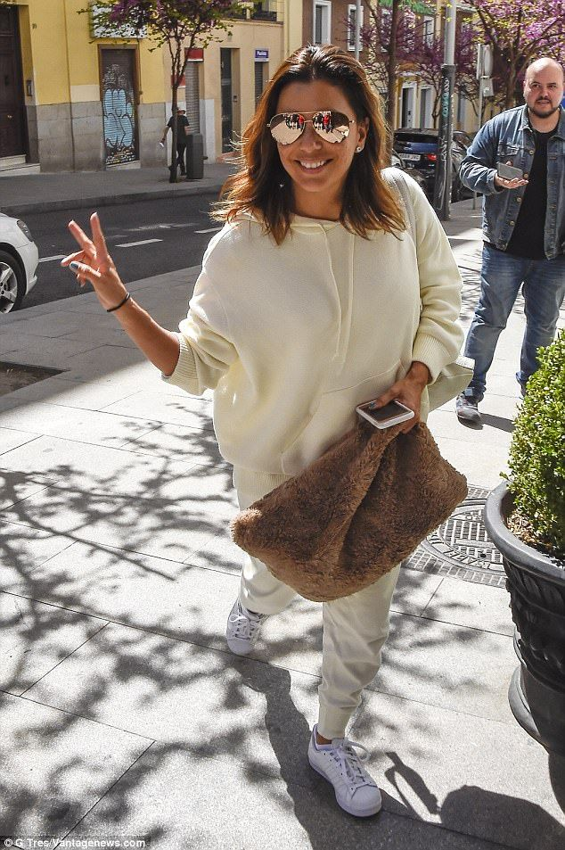 Cozy and chic:Earlier on Monday, the actress looked relaxed in an over-sized white track s...