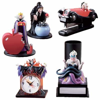 Evil Queen Grimhilde tape dispenser, Evil Queen Grimhilde [as the old woman] paper clip holder, Cruella de Vil stapler, Maleficent clock & Ursula pencil holder.