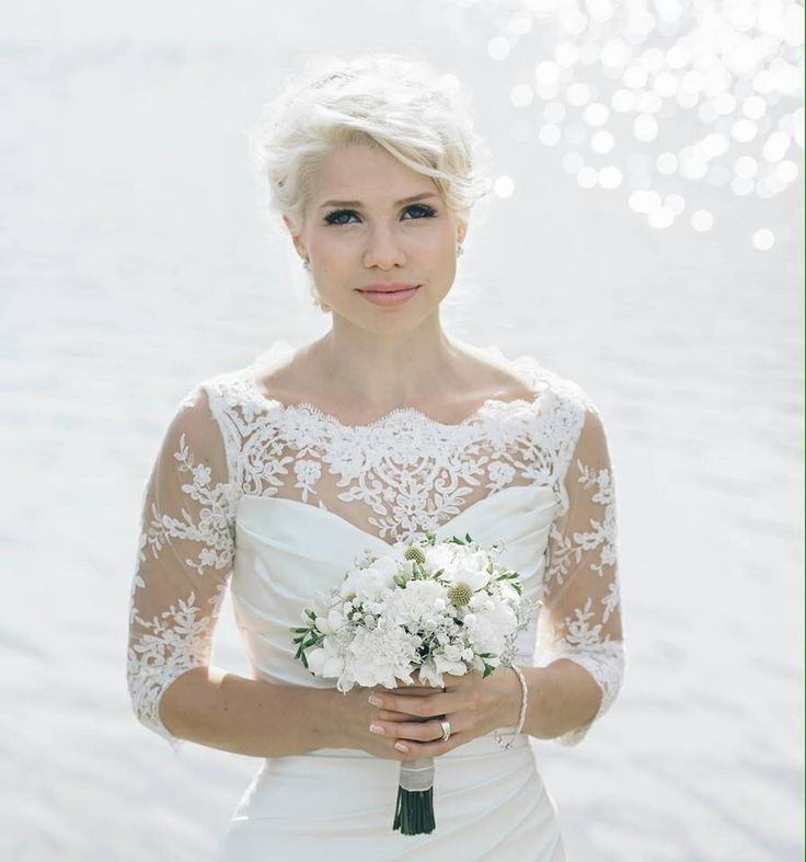 "Me on my wedding day! A white lace wedding dress with a removal ""jacket"". Designed by me, executed by Ateljee Iina in Jyväskylä, Finland. My beautiful wedding hair-do done by my talented sister. Photographer Tiitu Design."