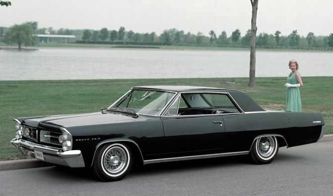 1963 Pontiac Grand Prix - After the 63-65 Buick Riviera, one of the most restrained US Automotive designs of the '50 and '60's. Critically,  while it forged the slab sides of Cadlillac's range, it lacked the taut lines of the Riviera, and the classic 'Coke Bottle' shape which dominated US Car Design for  10 years was born...K