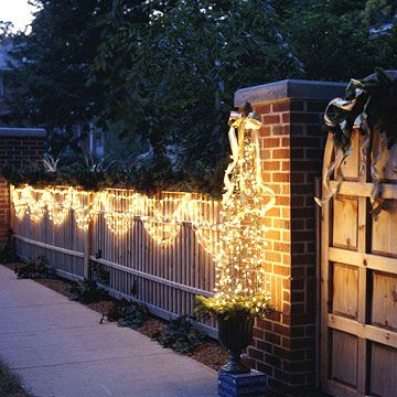 Using your Christmas lights as light swags is a beautiful (and cheap!) way to dress up your front yard! More lighting ideas: http://www.bhg.com/christmas/outdoor-decorations/outdoor-christmas-lights/?socsrc=bhgpin121313swagsoflight&page=24