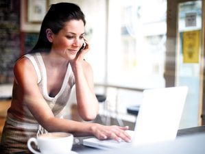 Woman at coffee shop, laptop, cell phone, coffee, latte, coffee mug