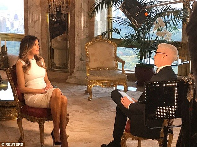 Different story: Melania Trump said that Bush 'egged' her husband on and got him to say 'dirty and bad stuff' in an interview with Anderson Cooper on Monday evening (above)