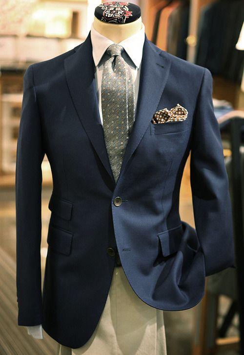 Navy sport coat, white shirt, light grey tie, khakis