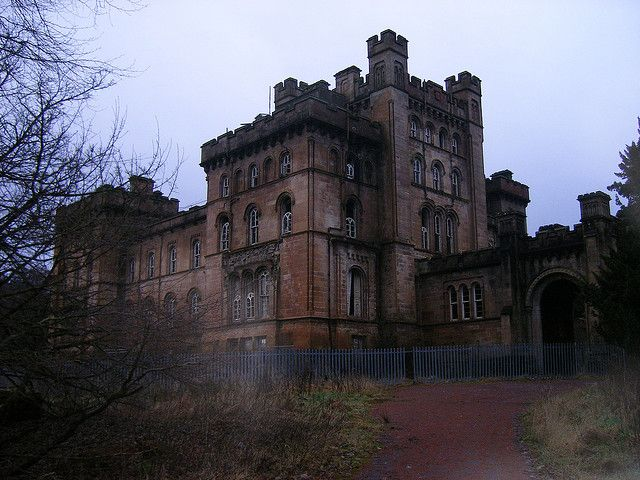 The Lennox Castle in Lennoxtown, Scotland - Lennox Castle was built between 1837 and 1841, in the square style of a Norman castle for John Lennox Kincaid by architect David Hamilton. During World War I the castle was requisitioned for use as a military hospital, then an asylum, and later abandoned in 1987. Although there have been proposals to redevelop the castle, no work has been done and the castle continues to decay.