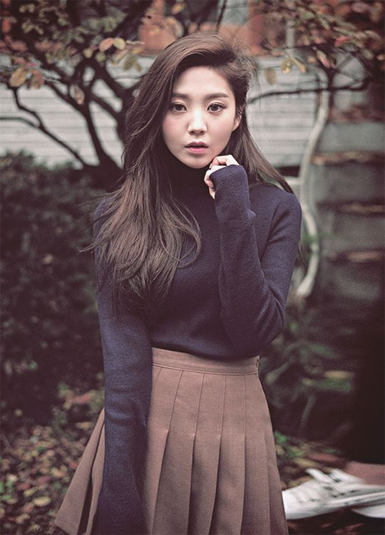 Navy turtleneck with beige cheerleader skirt. Perfect for those crisp fall days.