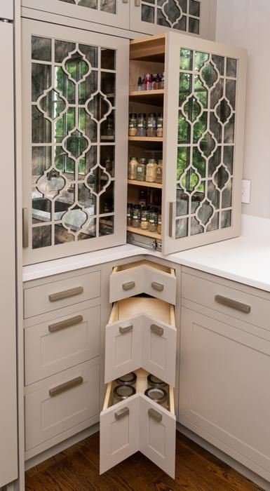 mirrored cabinet doors & cut-out design (HATE the lower corner drawers!)  Photos: 2014 Kitchen and Bath Business' Kitchen of the Year Runner-Up