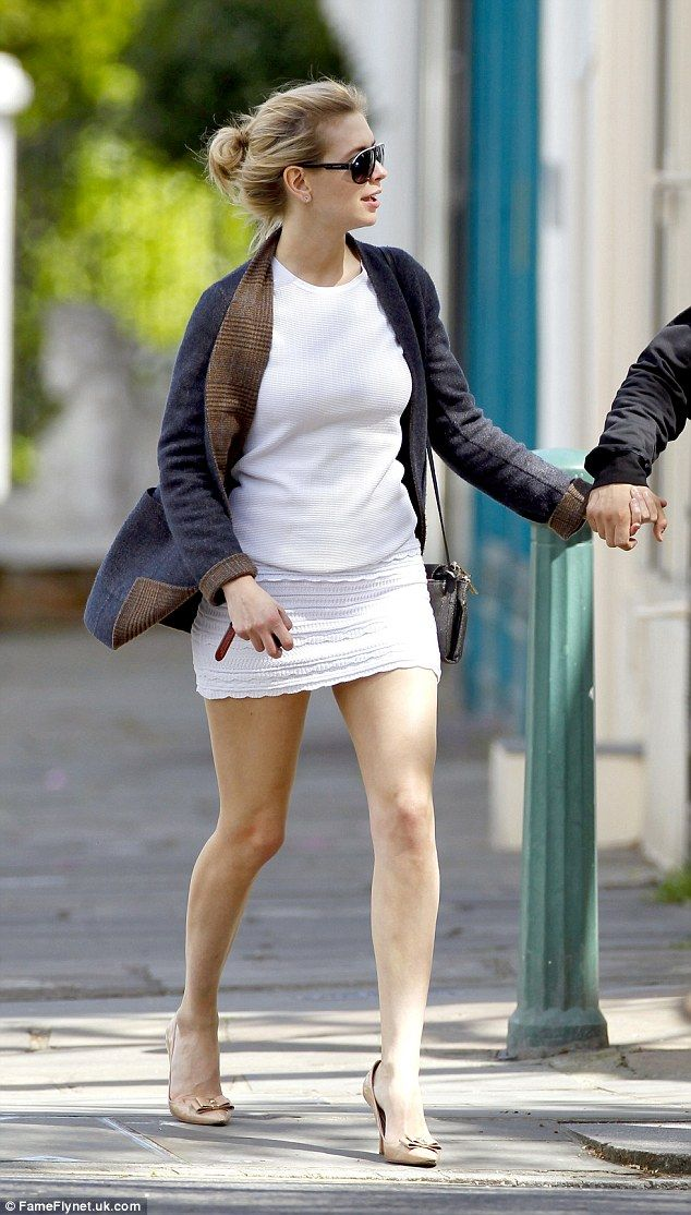 Leggy look: Rachel showed off her long legs in a white top paired with a matching mini, se...