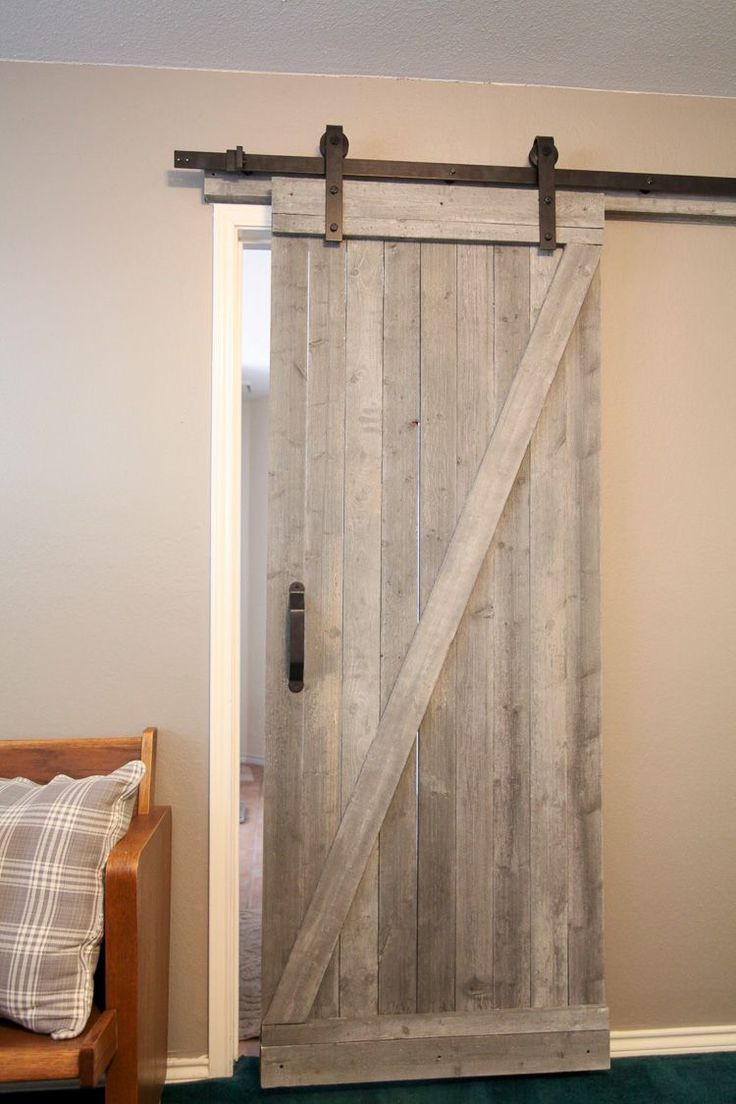 This easy to make rustic barn door is beautiful and easy to make! I love this fo…