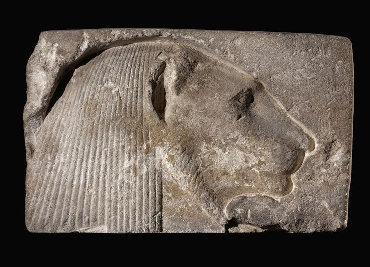 Egyptian limestone relief fragment, New Kingdom, 18th Dynasty, 1554-1305 B.C. Carved in sunk relief with a lion-headed divinity facing right and wearing a striated wig falling behind the deeply carved ear, the ruff around the finely-carved face in low incised relief, traces of pigment, 27 x 43.8 cm. Private collection