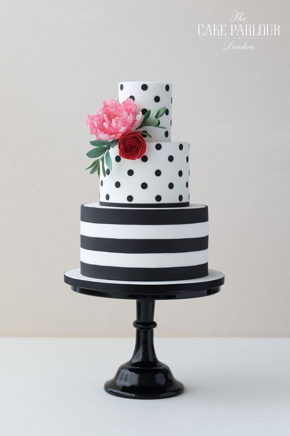'SIMPLY STRIPES & DOTS' Wedding Cake - Striking and fun black and white stripy and dotty wedding cake decorated with sugar Angelique Tulip and Ranunculus.