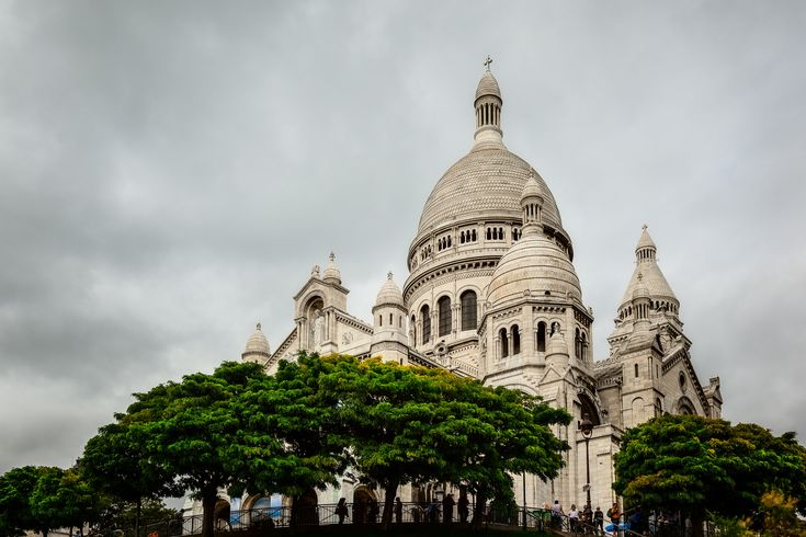 An upward view of the beautiful Sacre Coeur Basilica in Montmarte in Paris, France.