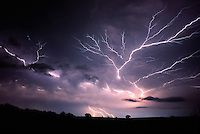 """Anvil Crawler"" a form of cloud-to-cloud lightning, splays it's raw power across the night sky east of Norman Oklahoma on July 7th, 1994."