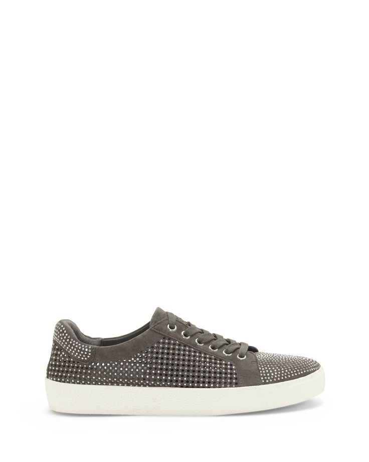 Never miss a beat in this hip street sneaker designed for comfort and style. The Chenta sneaker dazzles with metallic studs on the toe box, collar and around the perforated vamp. Lace up these dream sneaks with tights and a T-shirt dress or a pocket tee and overalls. Suede or nubuck upper, leather lining, synthetic sole Imported