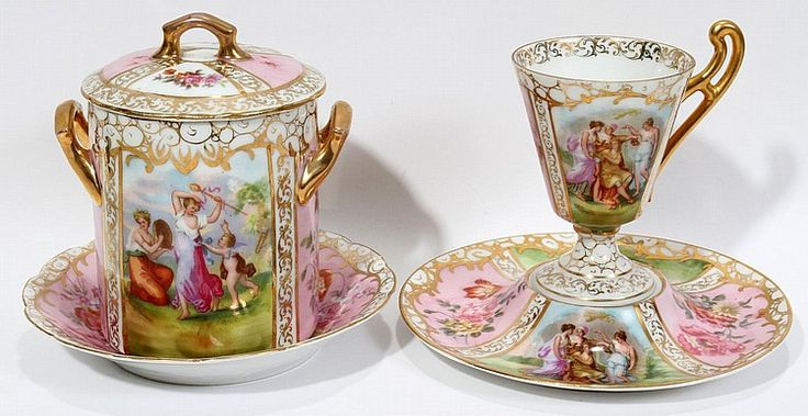 """AUSTRIAN PORCELAIN JAM JAR ON A PLATE & CUP AND SAUCER, EARLY 20TH C.: Royal Vienna style porcelain includes 1 covered jam jar [without liner], H.5"""", with 1 under plate, Dia.5 3/4"""", 1 coffee cup with 1 saucer; each piece is transfer-decorated with alternating classical style and floral reserves, gilt accents, and marked in blue over glaze, possibly Schierholz & Son, and two pieces stamped """"Austria""""."""