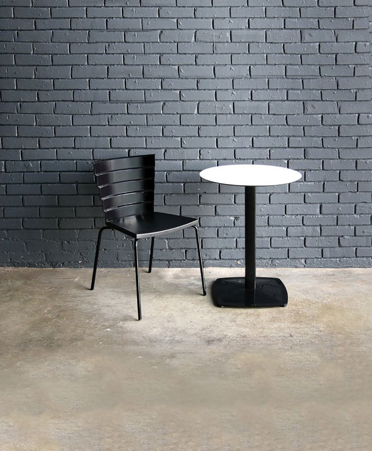 Bikini 1.0 in Black VR color from Sandler Seating. Polypropylene side chair on a steel sled base, designed by Marc Sadler and suitable for outdoor use.