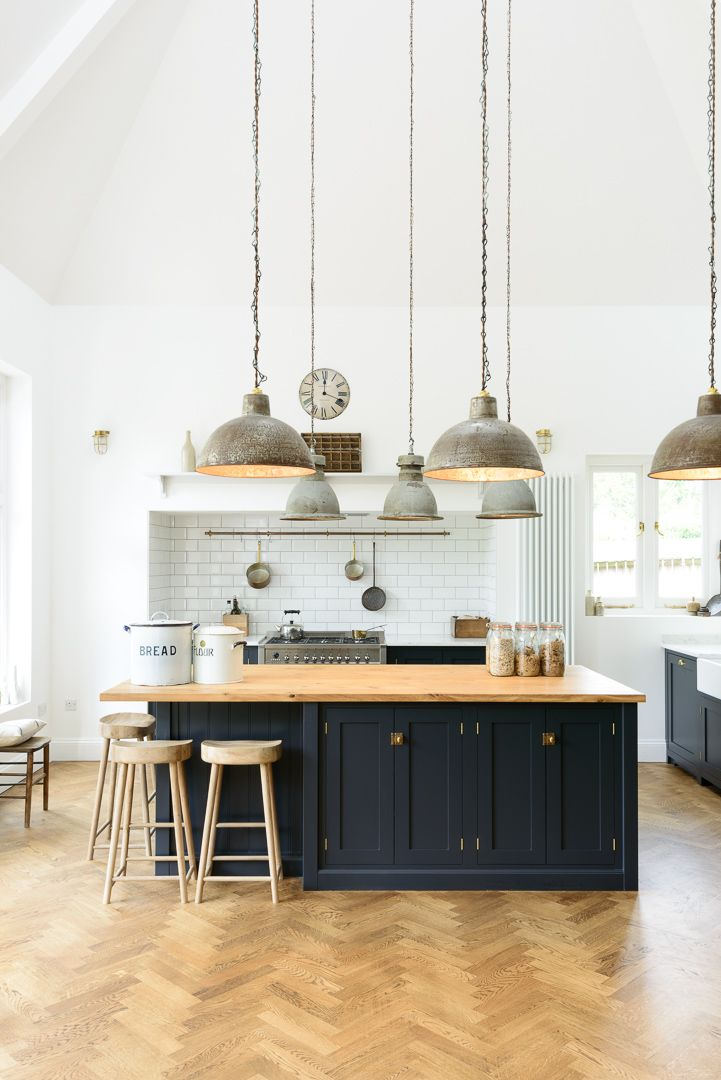 Vintage pendant lights, white metro tiles, original parquet flooring and beautifully simple deVOL Shaker cabinets in Pantry Blue make for a very cool kitchen