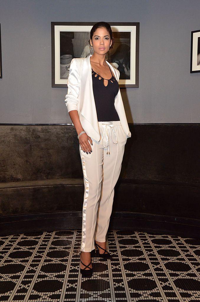 Model dressed in the white tuxedo jacket and white jogger pant  over Monaco Swimsuit