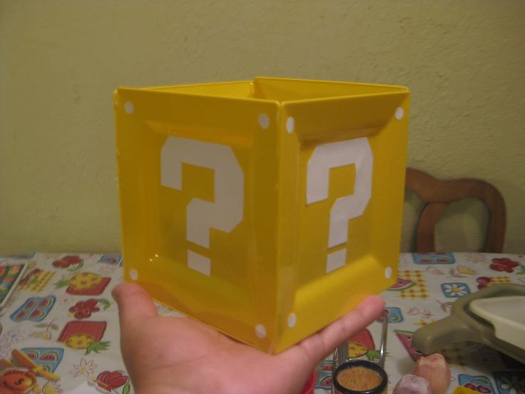 I made this awesome base for my centerpieces by simply hot gluing some square appetizer plates I found at Party City. The question mark pattern I found online and those perfect little circles I made with a whole puncher :)  Question mark link: http://www.instructables.com/id/Plush-Super-Mario-Block-with-Sound/