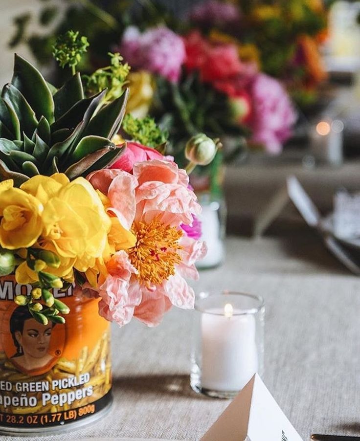 Looking for an easy way to add color to your #cincodemayo table? Use Mexican food cans as vases.  Festive and fun!