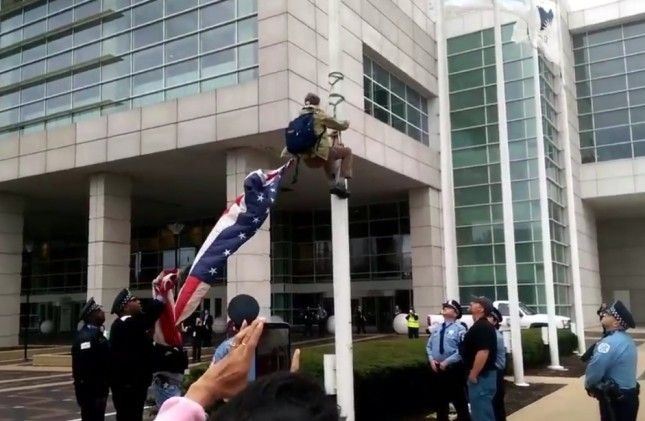 Black Lives Matter Protester Outside Police Chiefs' Convention Takes Down American Flag — Check Out What He Raises in Its Place