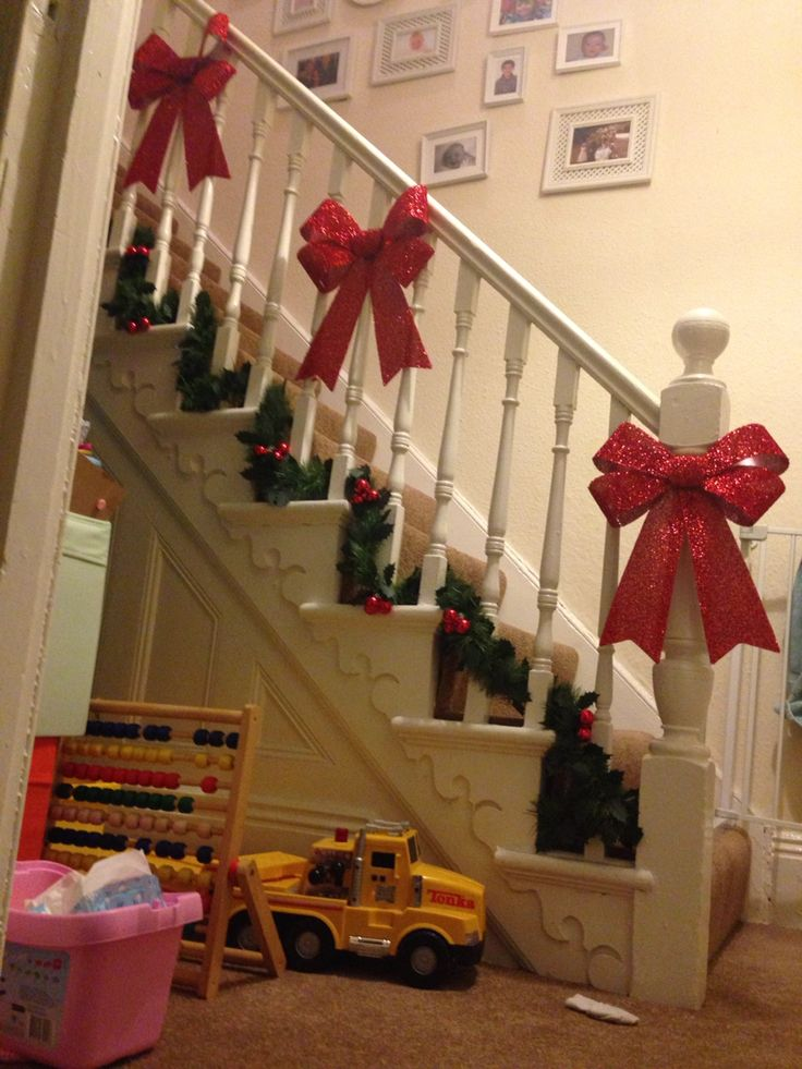 Pretty bows on the stairs for our first Christmas in our new home!
