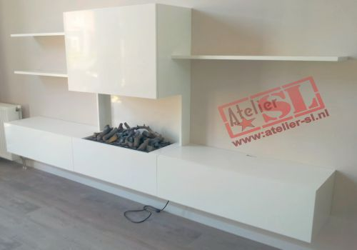 Het meubel bestaat uit een ombouw voor een elektrische haard twee kasten met kleppen en drie - Planken modern design ...