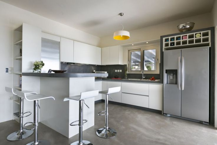 The well equiped kitchen is to the left of the dining area and has a cleverly designed breakfast-bar.