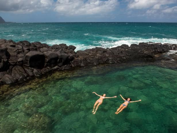 From Hawaii to Zambia and everywhere in between, these secret swimming spots around the world make for serious bucket list material.