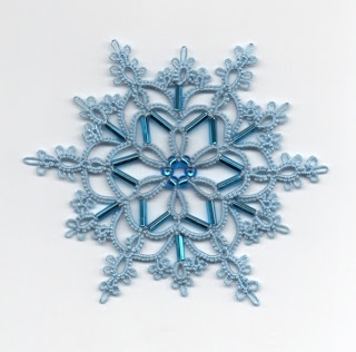 snowflake my favorite pattern! Love how she used the long beads for the picots! by Frivole