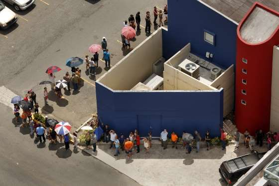 People desperate for cash line up at the Banco Popular in San Juan. - Provided by Esquire