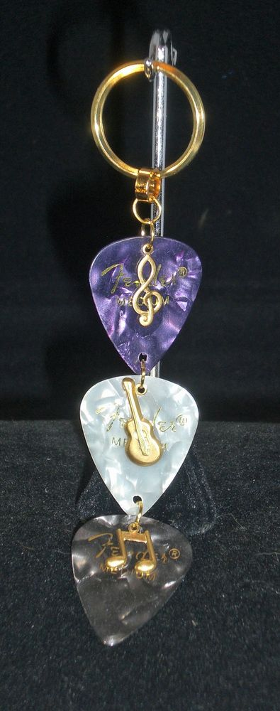 Keyring, purple, white and black guitar picks and gold music charms, $15.0