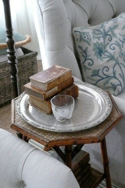 silver tray -so many uses; I use them on all my side tables instead of coasters