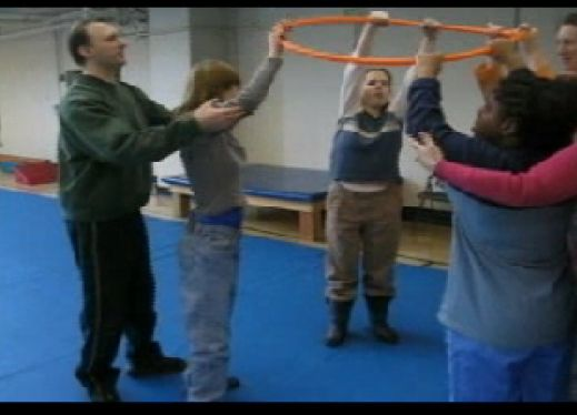 This is a warm up for an adapted physical education class.  With large groups, students work on lifting the hoop over their head in a team effort.  This warm-up is great for students who have visual, intellectual, or physical disabilities.