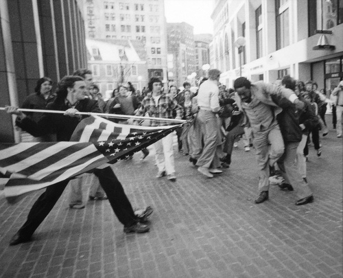 """""""The Soiling of Old Glory,"""" Stanley J. Forman's Pulitzer Prize-winning photograph. Boston, April 5, 1976."""