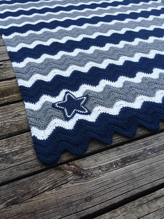 Soft and warm Blue, Grey and White striped crochet Afghan! Made in Dallas Cowboys colors with my rendition of a crochet Dallas star appliques in the corner! I can do any team you want! Available in multiple sizes from baby blanket size to full size bed! Want a custom size,