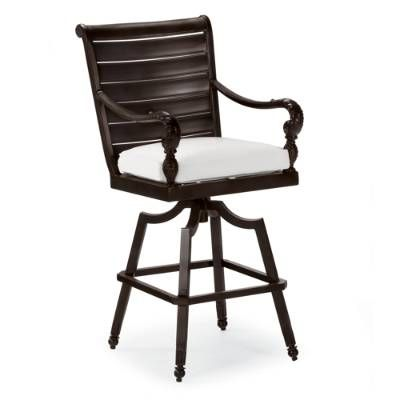 Our British Colonial Swivel Bar Stool invites you to entertain with a classically inspired form that features a generous dash of the exotic.         Plantation-shutter seat back is crafted from durable cast aluminum; frame is enhanced with cast-pineapple and acanthus leaf details. Estate-sized stool         includes thick seat cushion for lasting comfort.         Part of the British Colonial Collection.Fine furniture detailing100 ignot aluminum, a premium quality materialHand-filed we...