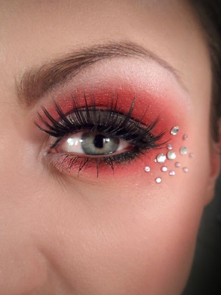 """""""An array of crystals accent red eye shadow and pretty lashes."""" Red eyeshadow, however bold I make it, makes me look like I'm dying of consumption."""
