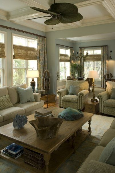 The coffered ceilings painted a faint blue between creamy white millwork, all the colors, the fabric on the curtains, beautiful rug, ceiling fan, comfortable furniture, natural woods, etc!