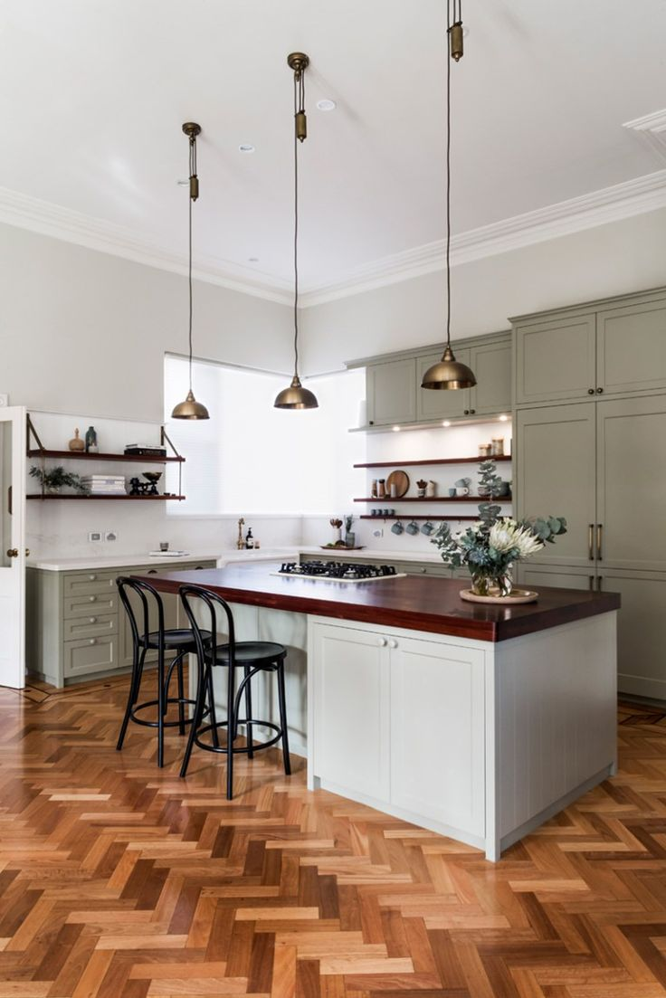 an amazing kitchen renovation with painted cabinets.