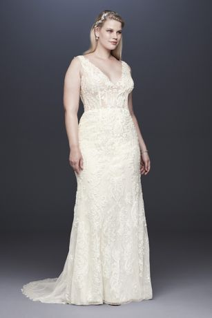 ce9fbd1f62dc The plunging tank bodice of this slim sheath wedding dress is a dramatic  show-stopper. Fully lined in beige illusion mesh