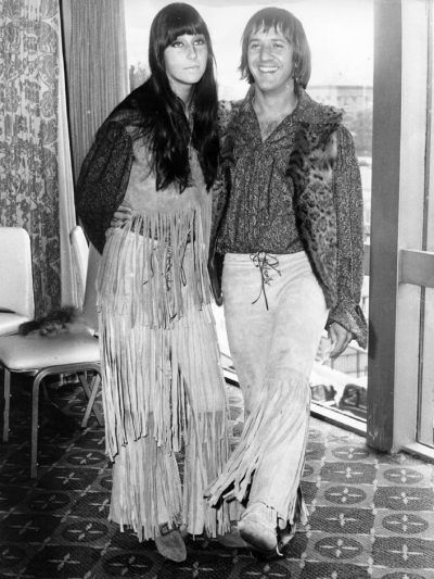 "In 1965, the Sonny (r.) & Cher song, ""I've Got You, Babe,"" knocked the Beatles off the top of the British music charts. English teenagers copied the singing duo's iconic fashion style. Their shows ""attracted girls who were ironing their hair straight and dyeing it black, to go with their vests and bell-bottoms"" (""Cher,' wikipedia). Cher was fond of fringe; Sonny, of fur."