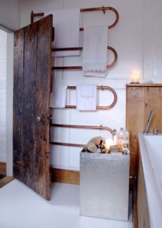 great copper piping heated towel rail  {i don't even need it to be heated... it just looks amazing!}