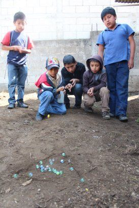 Games Children Play In Guatemala Cincos Marbles